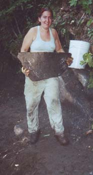 woman lifting large rock